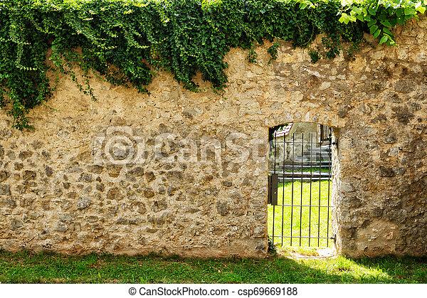 iron door in the stone wall - csp69669188