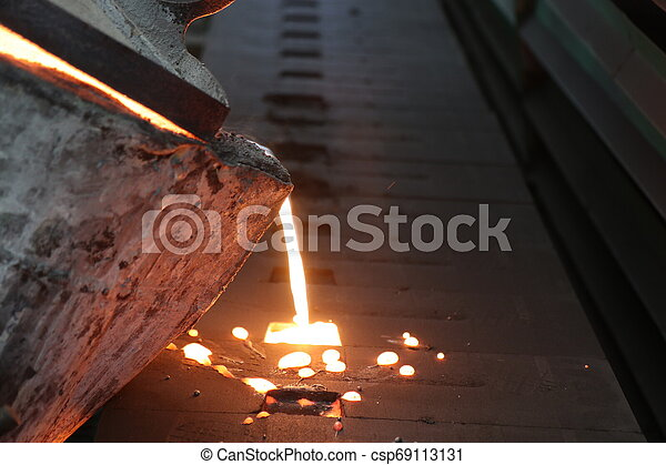 Iron molten metal pouring in sand mold - csp69113131