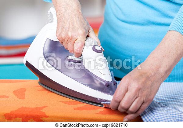 Ironing clothes - csp19821710