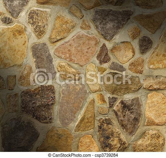 Muro de masones con piedras de forma irregular - csp3739284