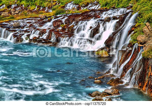 Hraunfossar Wasserfall in HDR, Eisland - csp11375720