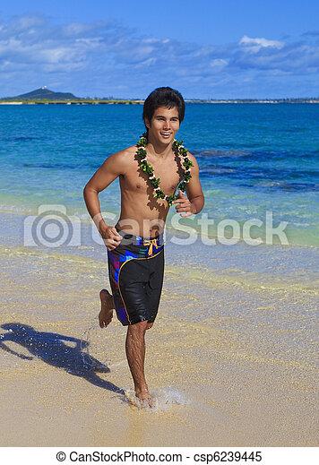 island man running on a hawaii beach - csp6239445