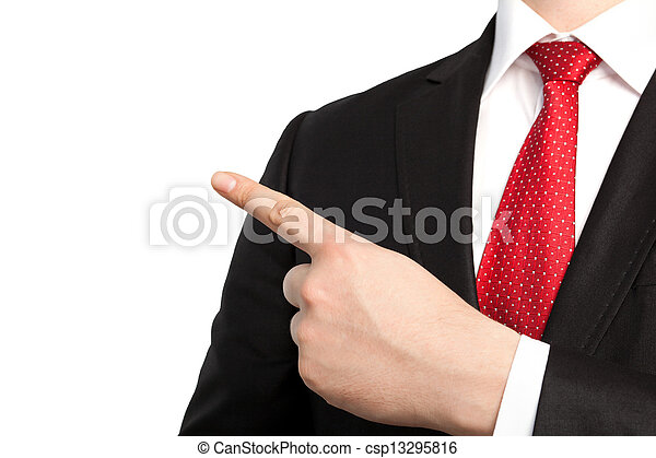 Isolated businessman in a suit and red tie points the finger at an object - csp13295816