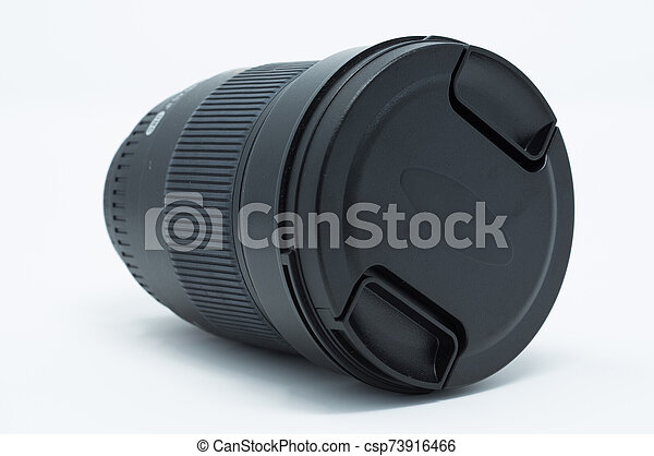 Isolated DSLR camera lens with cover on. - csp73916466