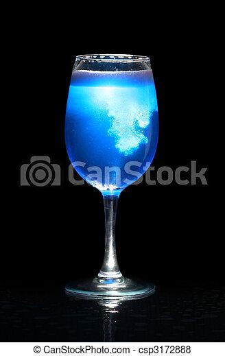 Isolated glass with blue splashing beverage - csp3172888