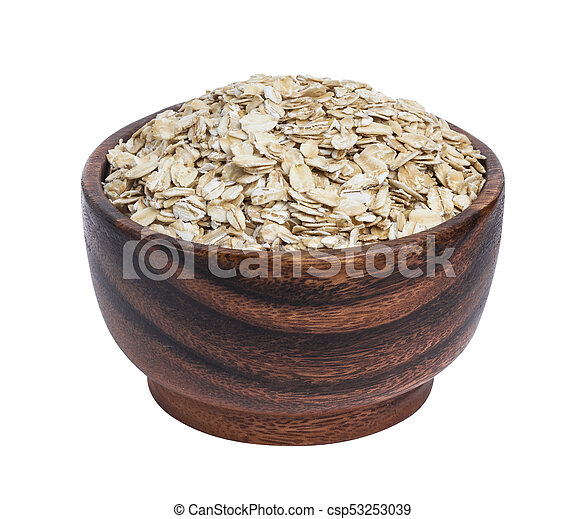 Isolated oatmeal. Oat flakes in wooden bowl on white background - csp53253039
