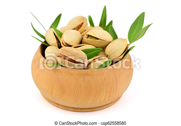 Isolated Pistachio Nuts in a Bowl. - csp62558580