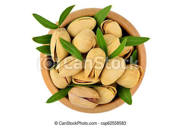 Isolated Pistachio Nuts in a Bowl. - csp62558583