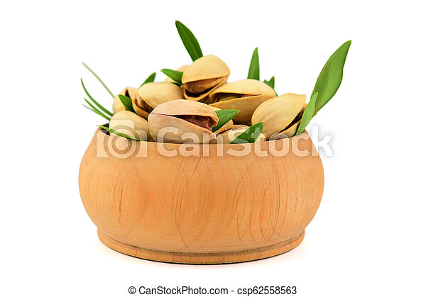 Isolated Pistachio Nuts in a Bowl. - csp62558563