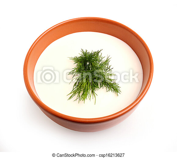 Isolated sour cream with a sprig of dill in a bowl. - csp16213627
