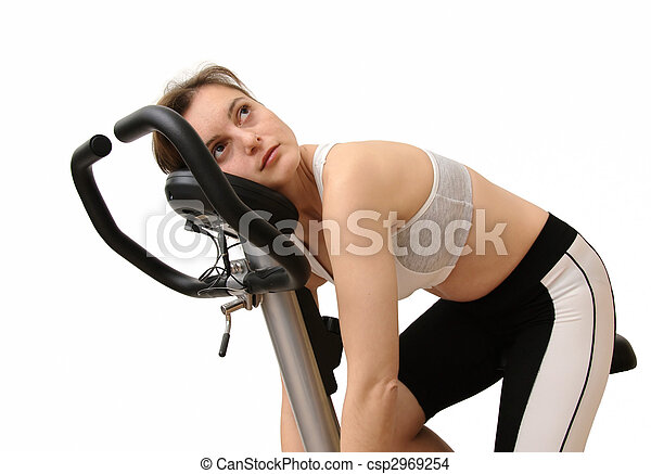 Isolated tired young woman siting on spinning bicycle - csp2969254