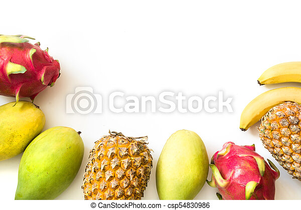 Isolated tropical fruits. Pineapple, banana, dragon fruit and mango isolated on white. Top view. - csp54830986