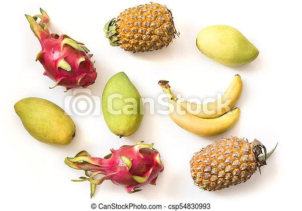 Isolated tropical fruits. Pineapple, banana, pitaya fruit and mango isolated on white background. - csp54830993