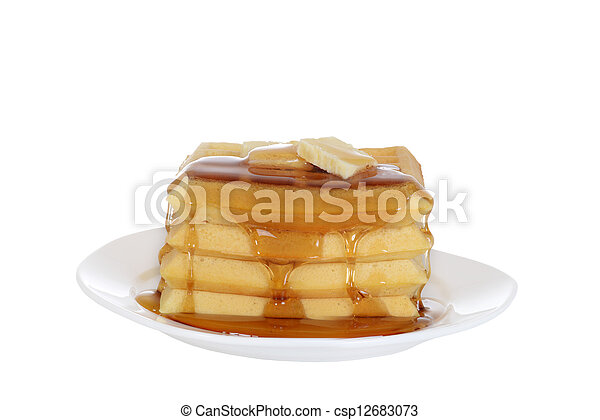 Isolated Waffles butter and syrup - csp12683073