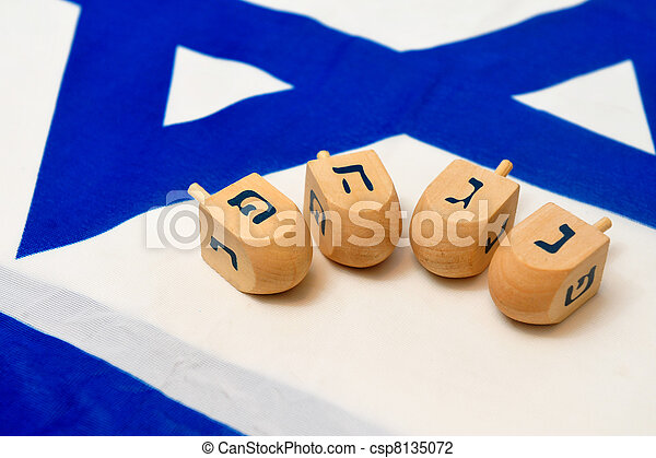 Israeli Flag with Wooden Dreidels - csp8135072