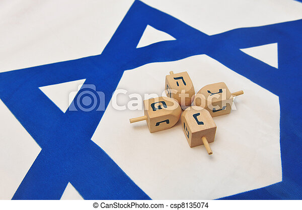Israeli Flag with Wooden Dreidels - csp8135074
