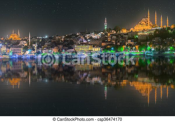 Istanbul skyline from Galata bridge by night - csp36474170
