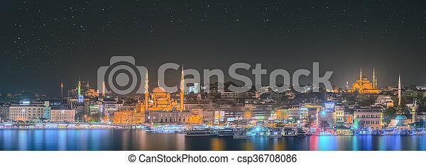Istanbul skyline from Galata bridge by night - csp36708086
