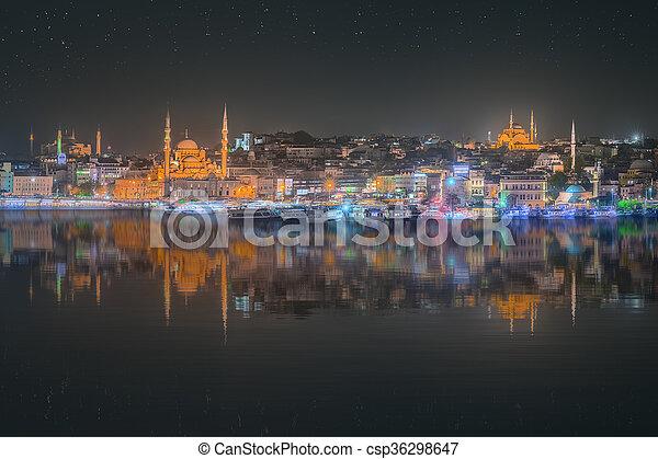 Istanbul skyline from Galata bridge by night - csp36298647