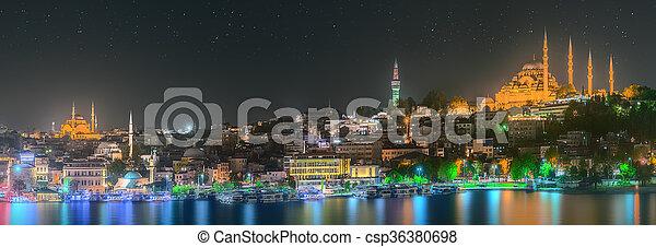 Istanbul skyline from Galata bridge by night - csp36380698