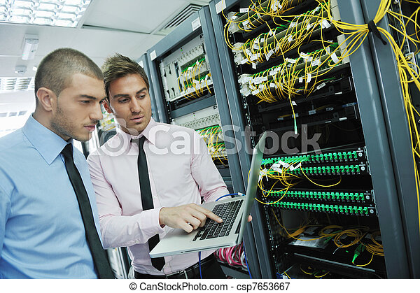 it engineers in network server room - csp7653667