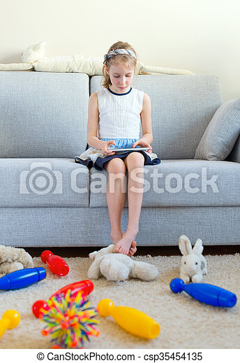 It 39 S Time To Clean Up Your Toys Little Girl Playing With Tablet