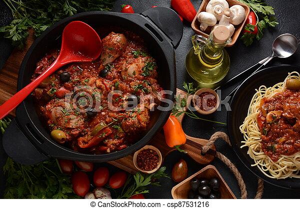 Italian chicken Cacciatore hunter's stew with spaghetti noodles - csp87531216