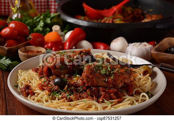 Italian chicken Cacciatore hunter's stew with spaghetti noodles - csp87531257