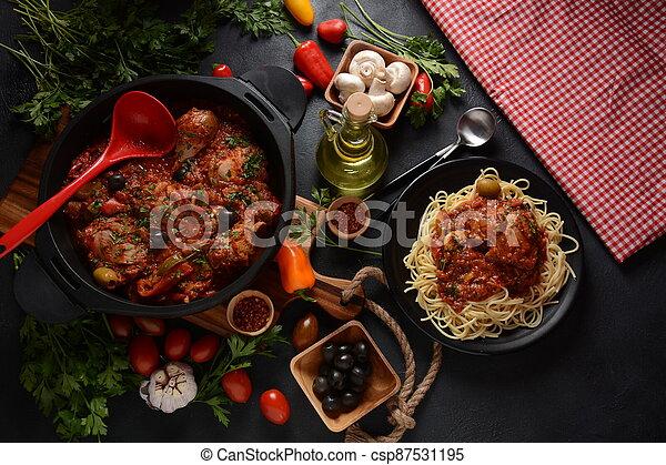 Italian chicken Cacciatore hunter's stew with spaghetti noodles - csp87531195