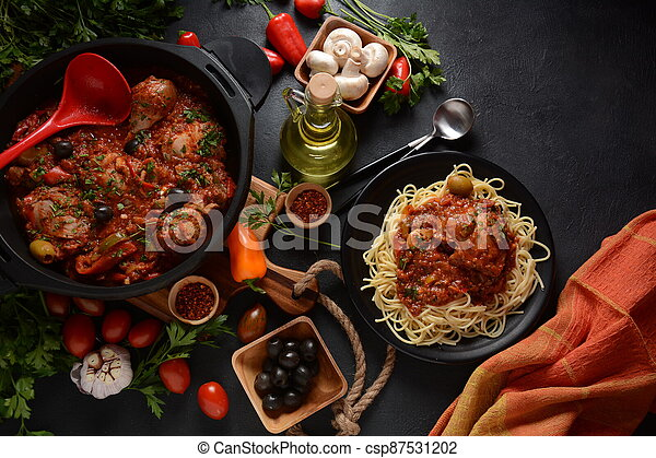 Italian chicken Cacciatore hunter's stew with spaghetti noodles - csp87531202