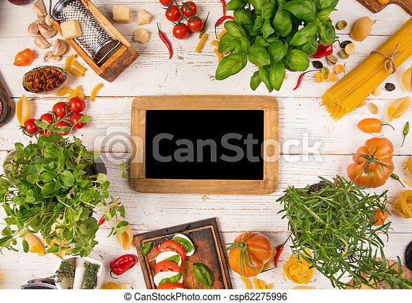 Italian food ingredients on old wooden background - csp62275996