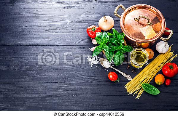 Italian food preparation pasta on wooden board - csp44012556