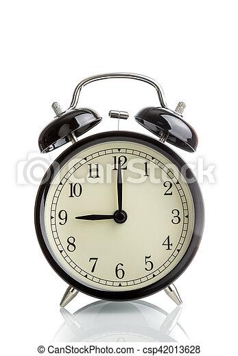 it's nine o'clock already, time to wake up for breakfast, vintage old black metallic alarm clock - csp42013628