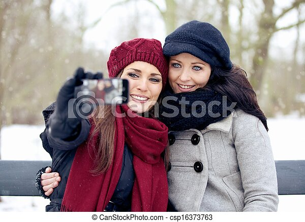 It's Picture Taking Time for These Beautiful Women Outdoors - csp16373763
