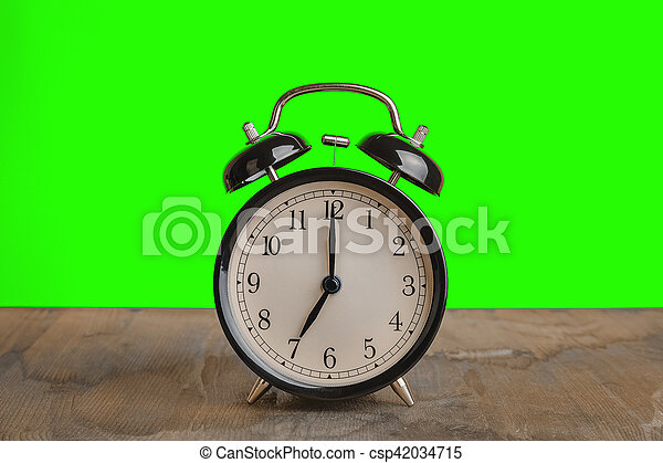 it's seven o'clock already, time to wake up for breakfast, vintage old black metallic alarm clock - csp42034715