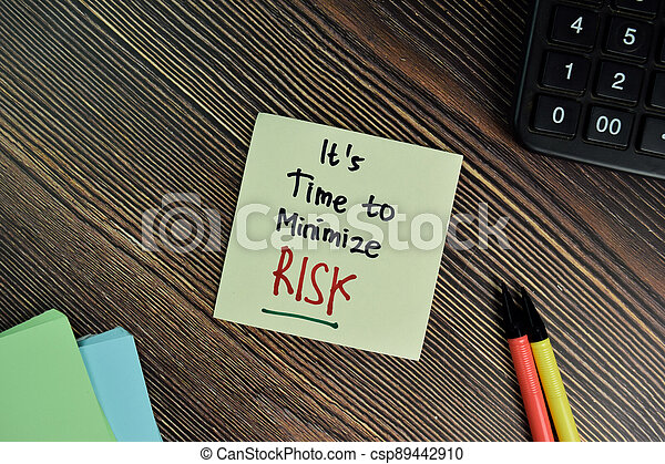 It's Time to Minimize Risk write on sticky notes isolated on Wooden Table. - csp89442910
