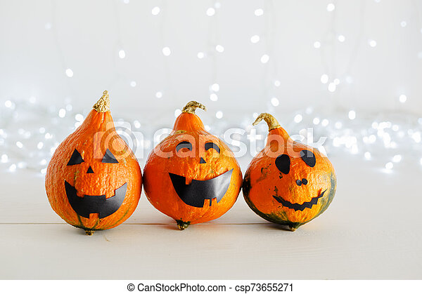 jack-o'-lantern on white background with lights. Happy Halloween party invitation, celebration. Halloween decorations concept. Copy space. - csp73655271