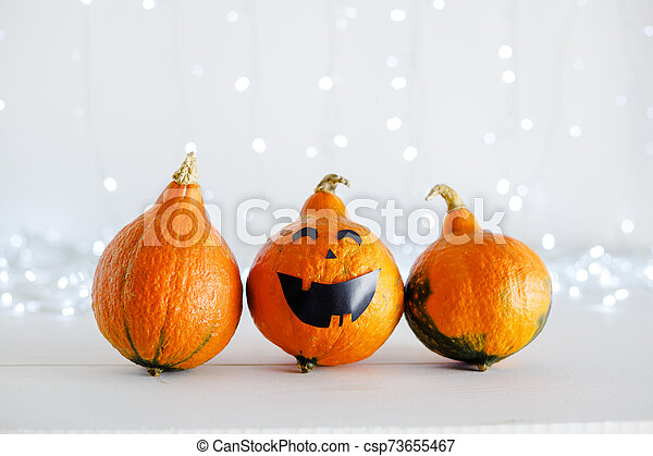 jack-o'-lantern on white background with lights. Happy Halloween party invitation, celebration. Halloween decorations concept. Copy space. - csp73655467
