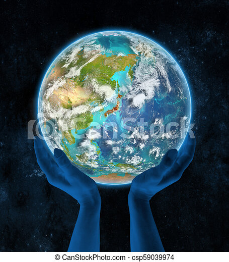 Japan on planet Earth in hands - csp59039974
