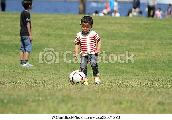 japanese boy kicking a soccer ball 3 years old