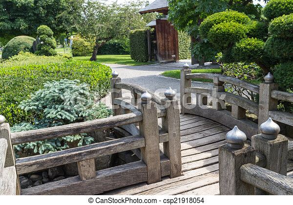 wooden bridge and walkway in a beatiful japanese garden