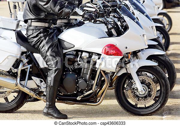 Japanese police man on motorcycle - csp43606333