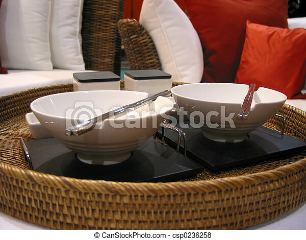 Japanese table setting with couch and pillows in the background.