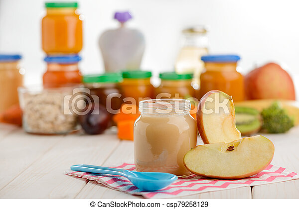 Jar of apple puree, slices and spoon - csp79258129