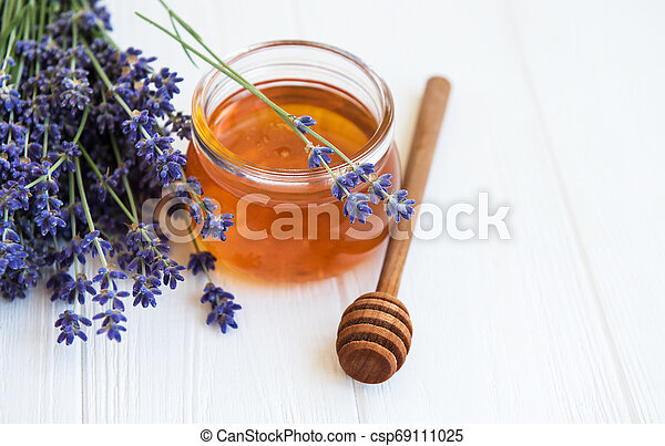 Jar with honey and fresh lavender flowers - csp69111025