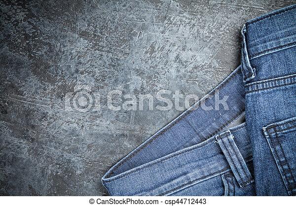 Jeans on dark background - csp44712443