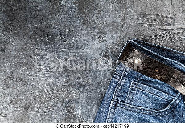 Jeans on dark background - csp44217199