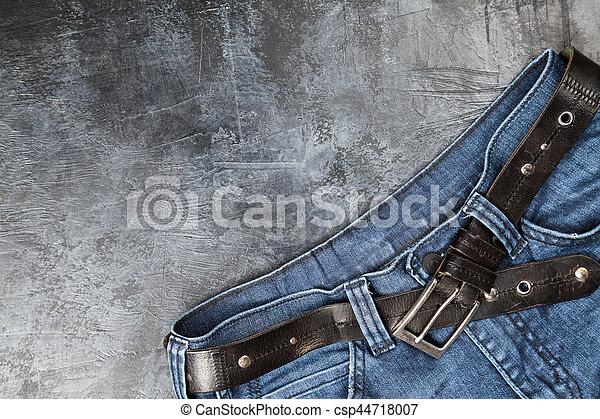Jeans on dark background - csp44718007