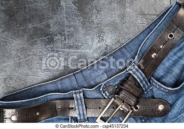 Jeans on dark background - csp45137234