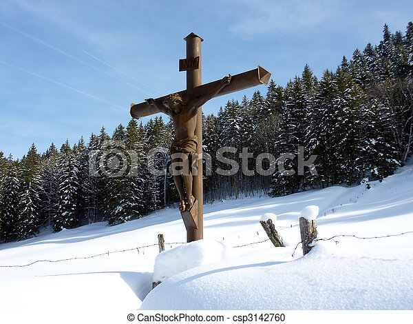 Jesus cross by winter. Jesus cross surrounded by snow and ...